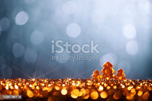 istock Golden Christmas Trees - Defocused Decoration Gold Blue Bokeh Glitter 1039796118