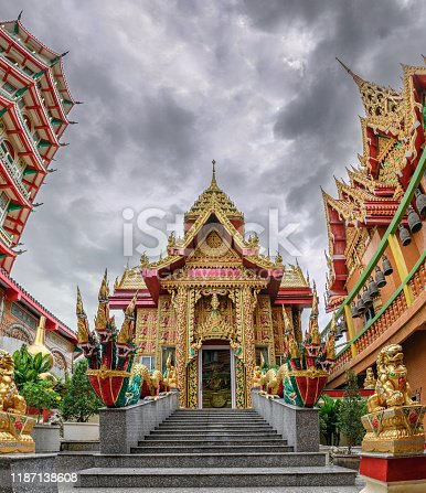 909806032istockphoto Golden church with storm in the sky inside of Wat Tham Sua Temple 1187138608