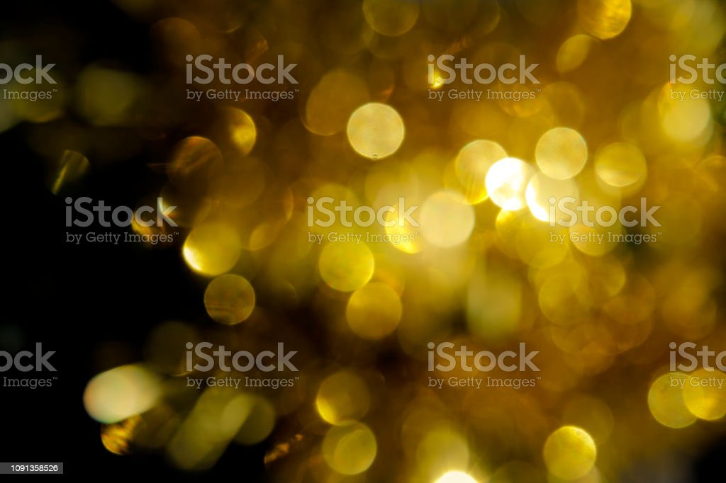 Golden circles of confusion make yellow background image stock photo
