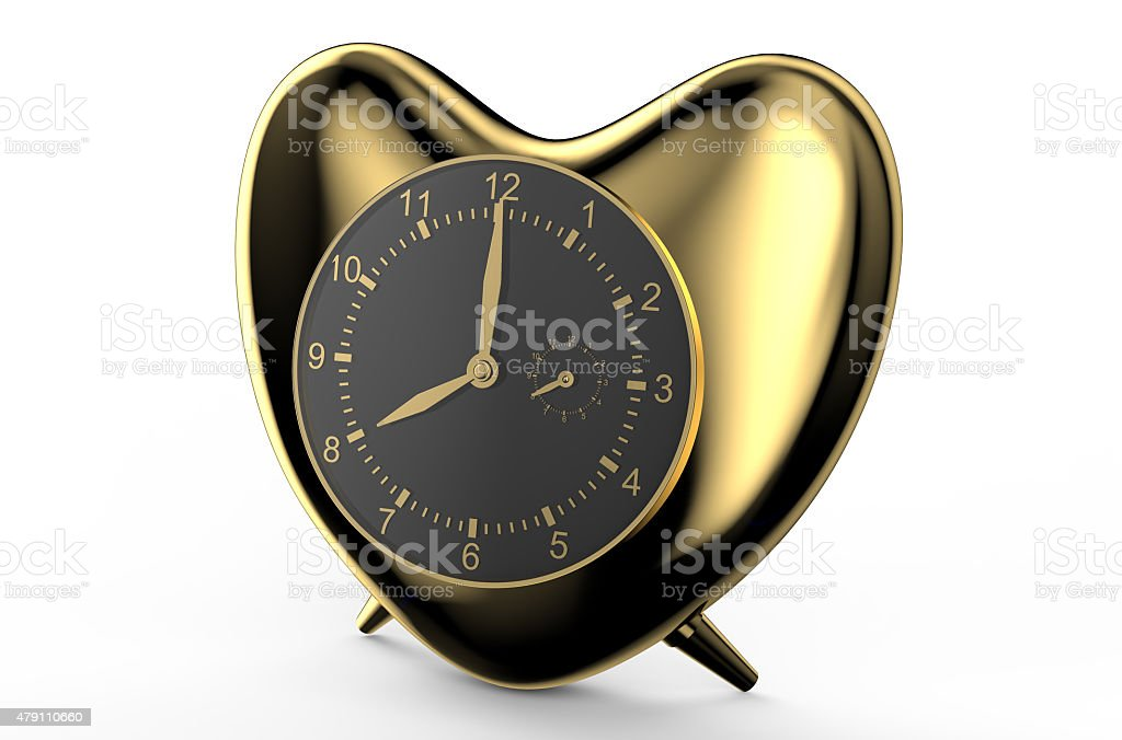 golden clock in the shape of heart stock photo