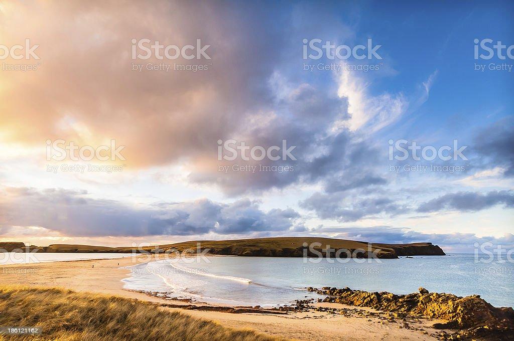 Golden clouds and tombolo St Ninians Isle Shetland Scotland stock photo