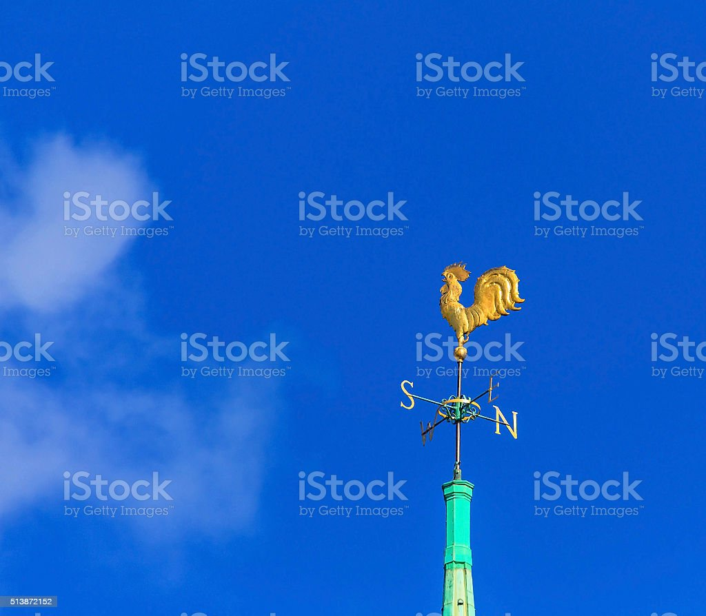 Golden cockerel on  spire of  Anglican Church on Trinity  Square stock photo