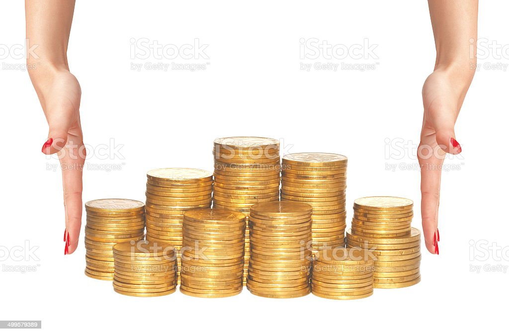 golden coins and woman hands isolated on white stock photo