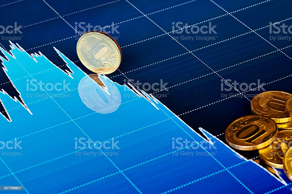 Golden coins on downtrend chart. Selective focus stock photo
