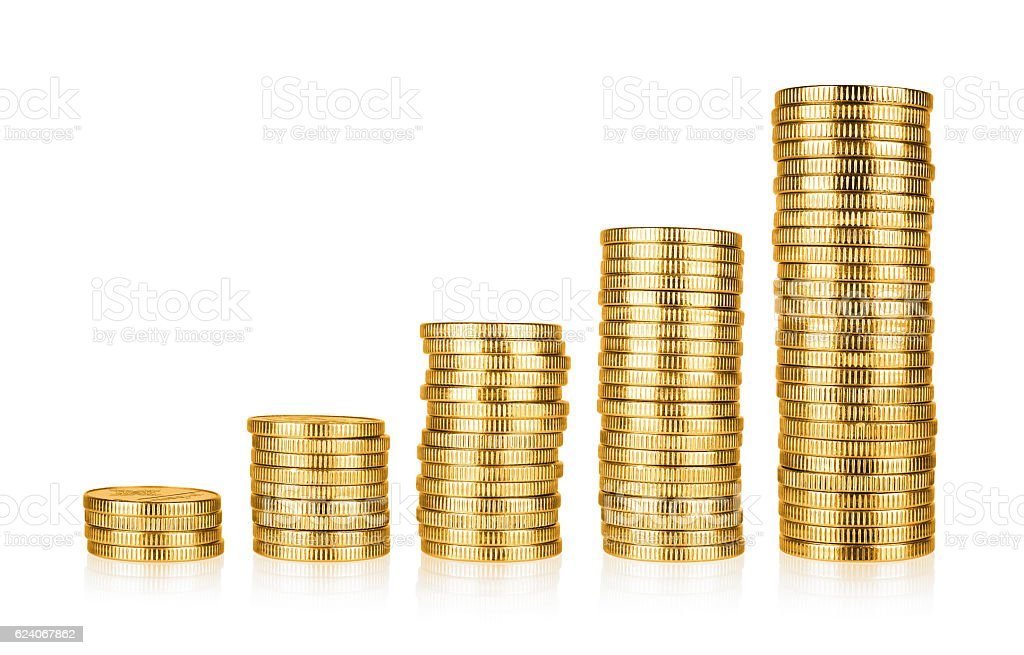 Golden coins stacks stock photo