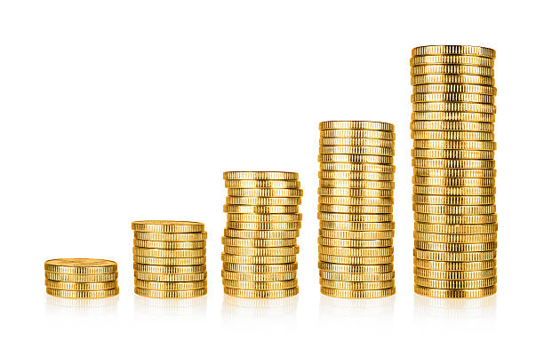Golden coins stacks stock photo