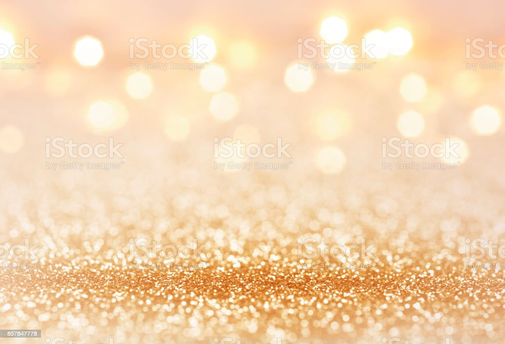 Golden color abstract glitter texture background for holidays stock photo