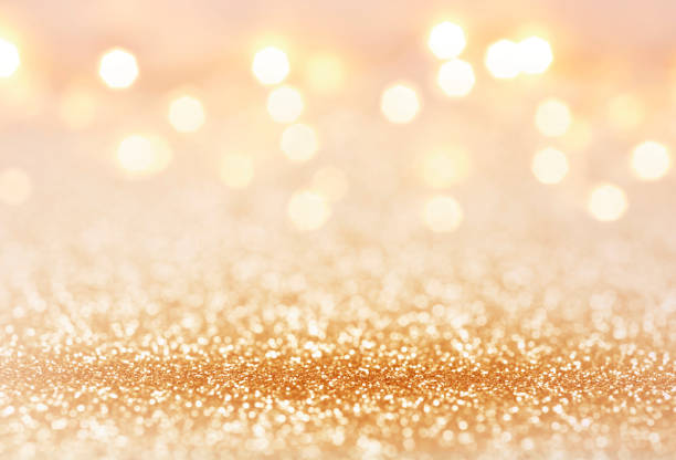 golden color abstract glitter texture background for holidays - scintillante foto e immagini stock