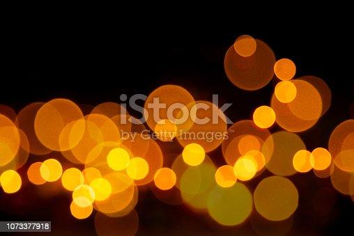 929640504istockphoto Golden color light of bokeh. 1073377918