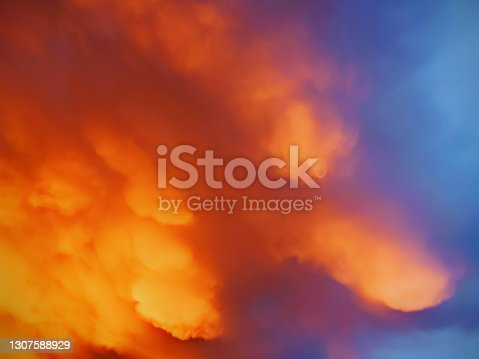 istock Golden colored evening view of Sunset with dramatic clouds 1307588929