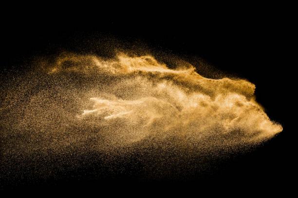 Golden colored sand splash against dark background yellow sand fly picture id985088610?b=1&k=6&m=985088610&s=612x612&w=0&h=ltqmcf64y9o09gp2xj ixf3mz ten0qdgijqbgbqgdk=
