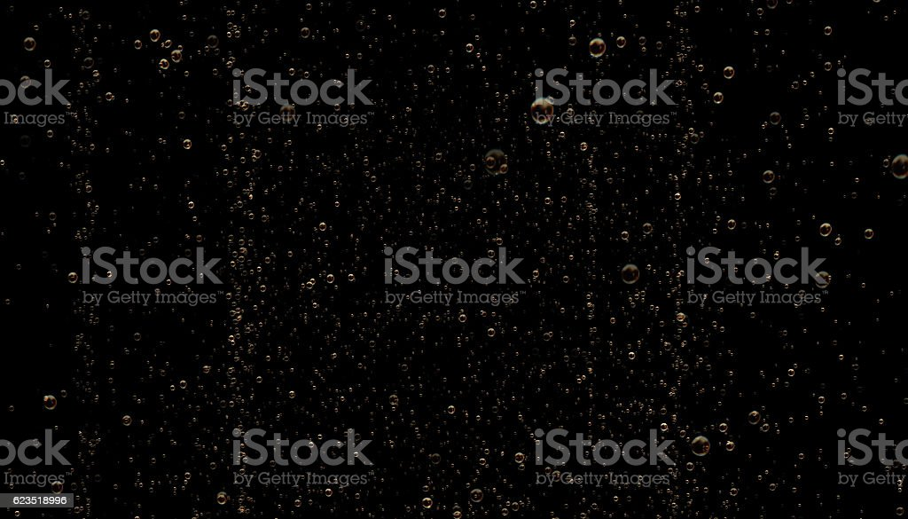 Golden Colored Sparkling Champagne Bubbles on Black Background stock photo