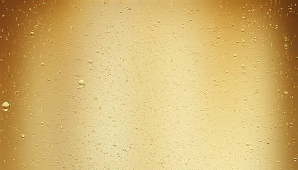 Golden Colored Sparkling Champagne Bubbles stock photo
