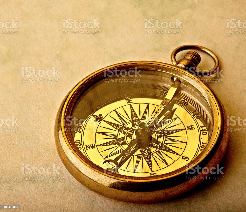 Golden compass stock photo