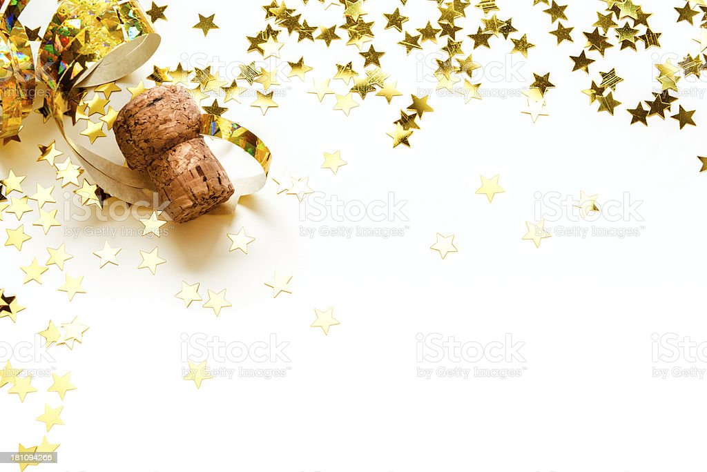 Golden confetti in stars shape, streamers, Champagne cork, isolated royalty-free stock photo
