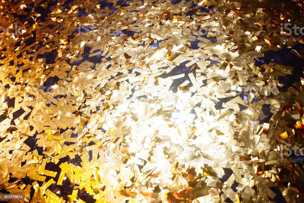 Golden confetti With Sparkling Glitter - Christmas and party background stock photo