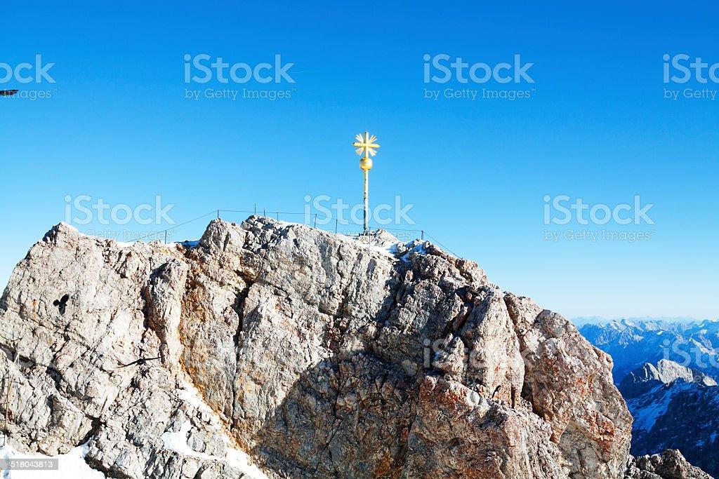 Golden cross of Zugsitze stock photo