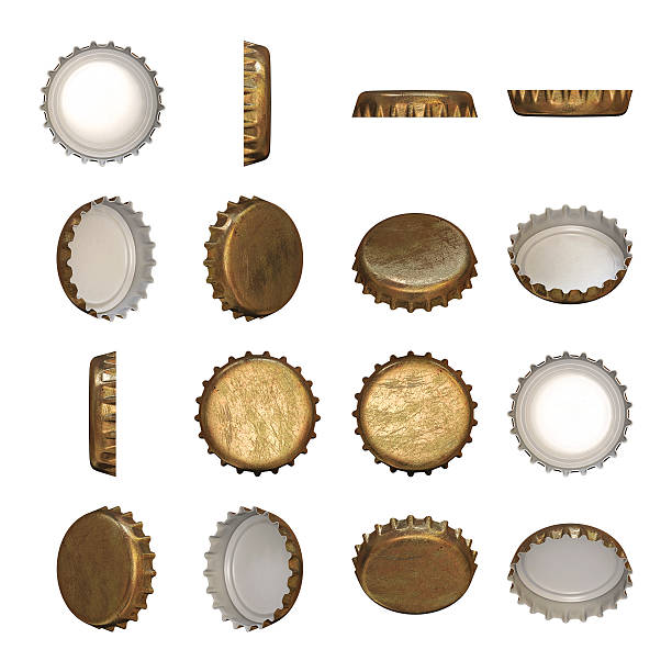 Golden crown cap A worn golden crown cap in different angles. bottle cap stock pictures, royalty-free photos & images