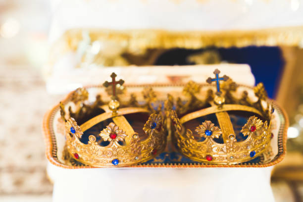 Golden crowns lying on the table in church stock photo