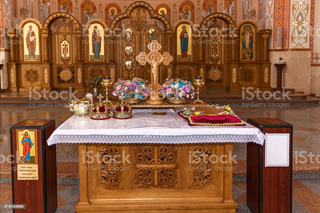 Golden crowns on altar stock photo