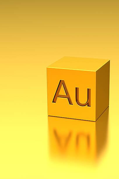 golden cube mit au-schild, metall hintergrund - aurum stock-fotos und bilder