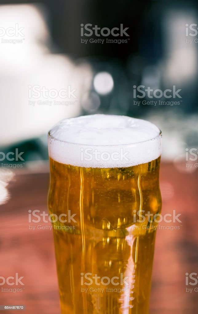 Golden dark beer isolated on bar surface stock photo