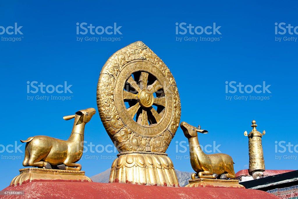 Golden Deer And Dharma Wheel in Tibet royalty-free stock photo