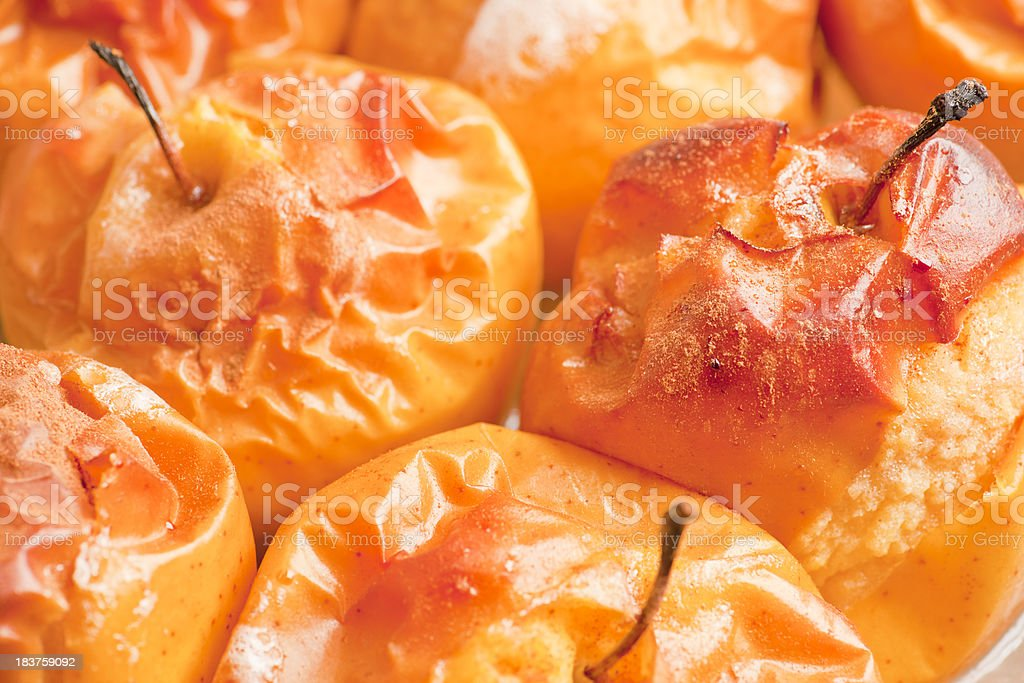 Golden Delicious Apples Baked in sweet wine with cinnamon sugar stock photo