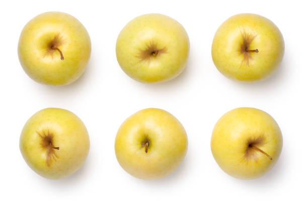 pommes golden delicious, isolées on white background - golden photos et images de collection
