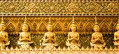 'demon statues at the Grand Palace in Bangkok, Thailand'