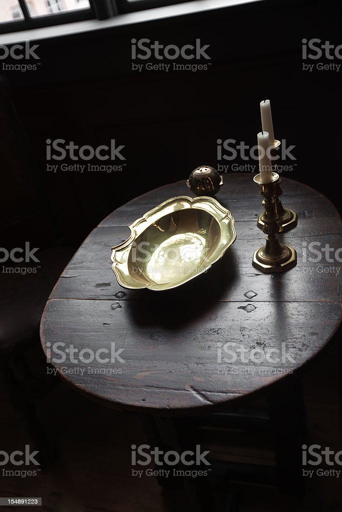 golden dish and candlesticks on the table royalty-free stock photo