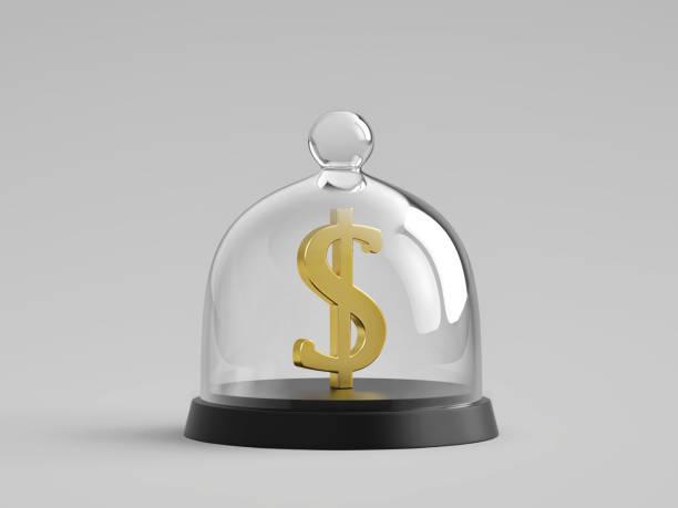 Golden dollar sign under glass bell jar stock photo