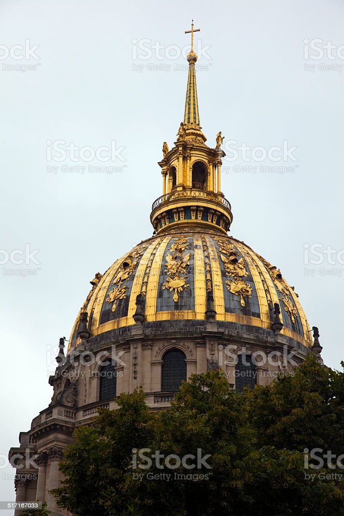Golden dome through the trees in Paris France stock photo