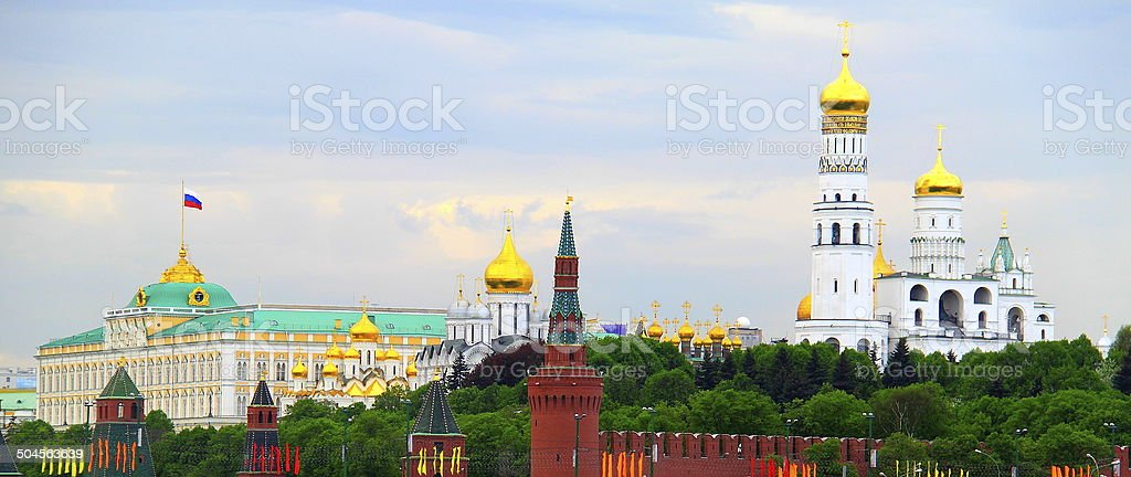 Golden domes and Kremlin Palace flag, Moscow, Russia stock photo