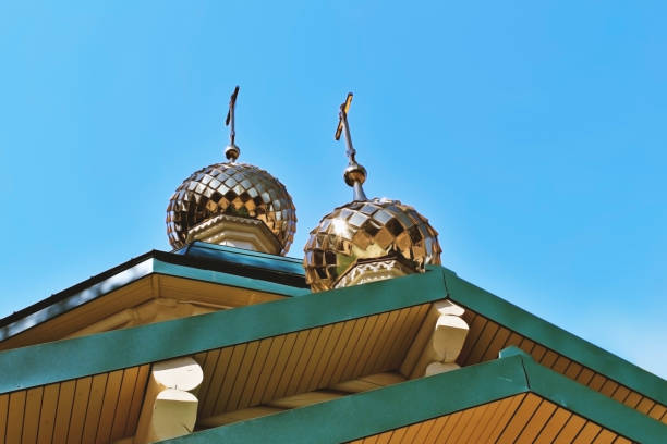 golden domes with crosses on the  temple church chapel, a religious christian building of wooden logs bottom view - cupola stock pictures, royalty-free photos & images