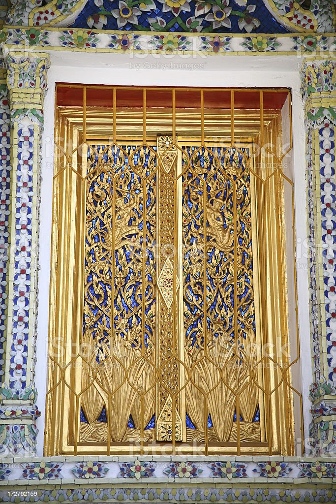 Golden door inside the Grand Palace in Bangkok, Thailand royalty-free stock photo