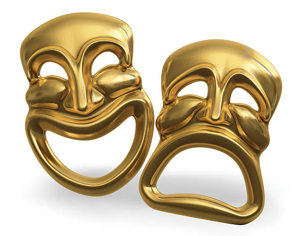 Golden dramatic masks representing comedy and tragedy stock photo