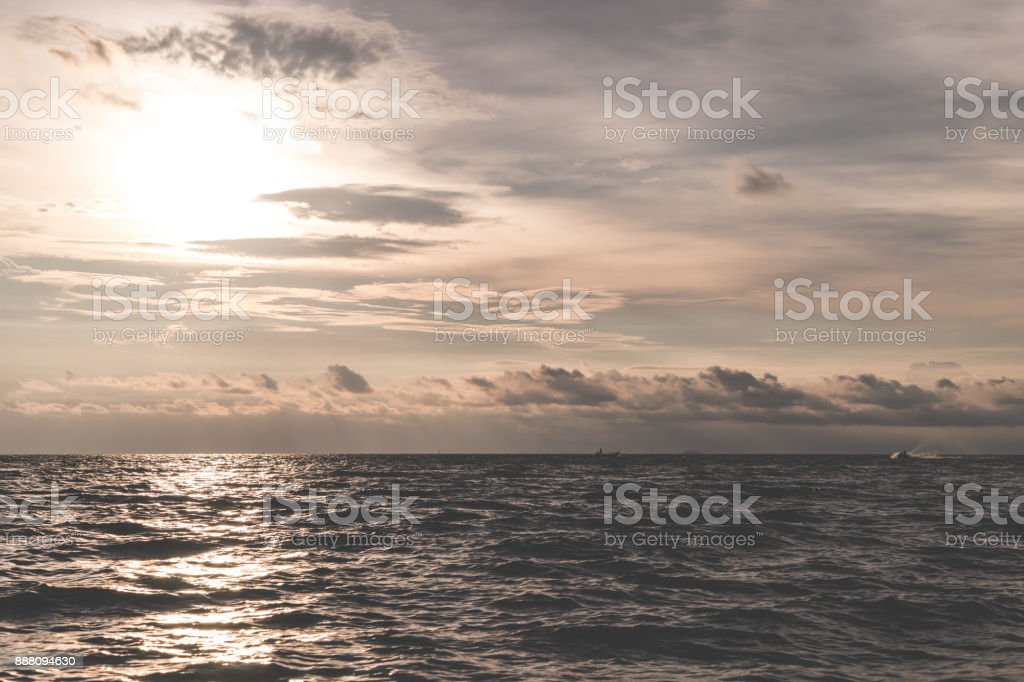 Golden Dramatic Ocean Sky With Sun Reflected On Waves Stock