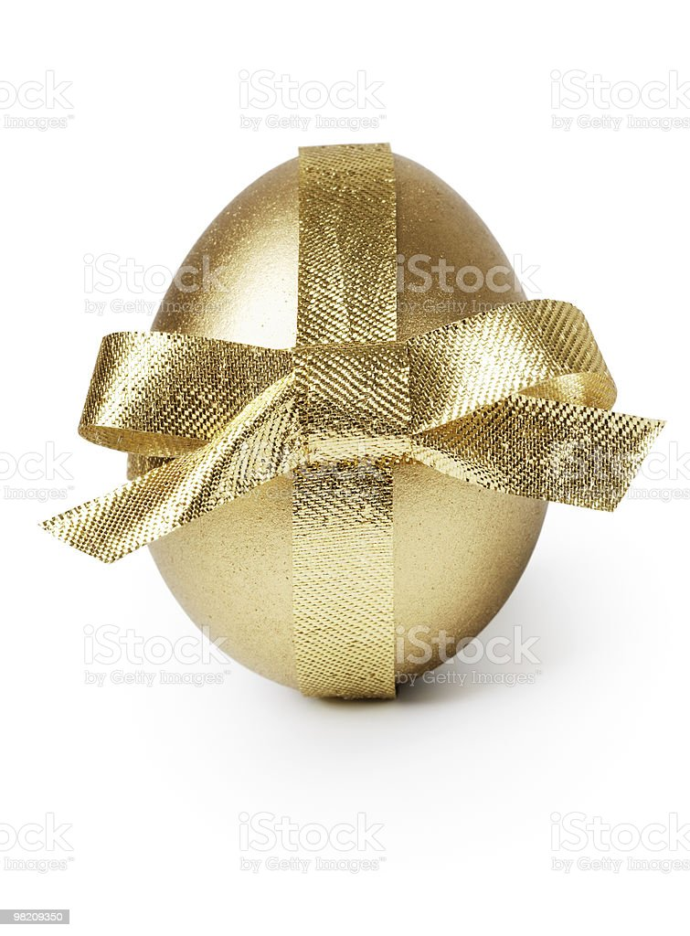 Golden egg and ribbon royalty-free stock photo