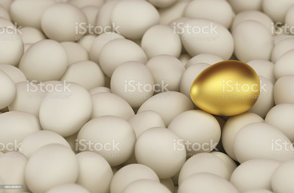 Golden egg between usual white eggs stock photo