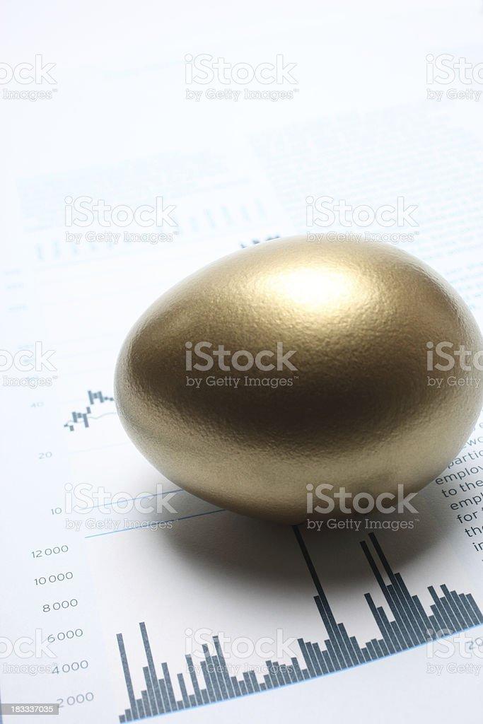 Golden Egg on Stock Chart royalty-free stock photo