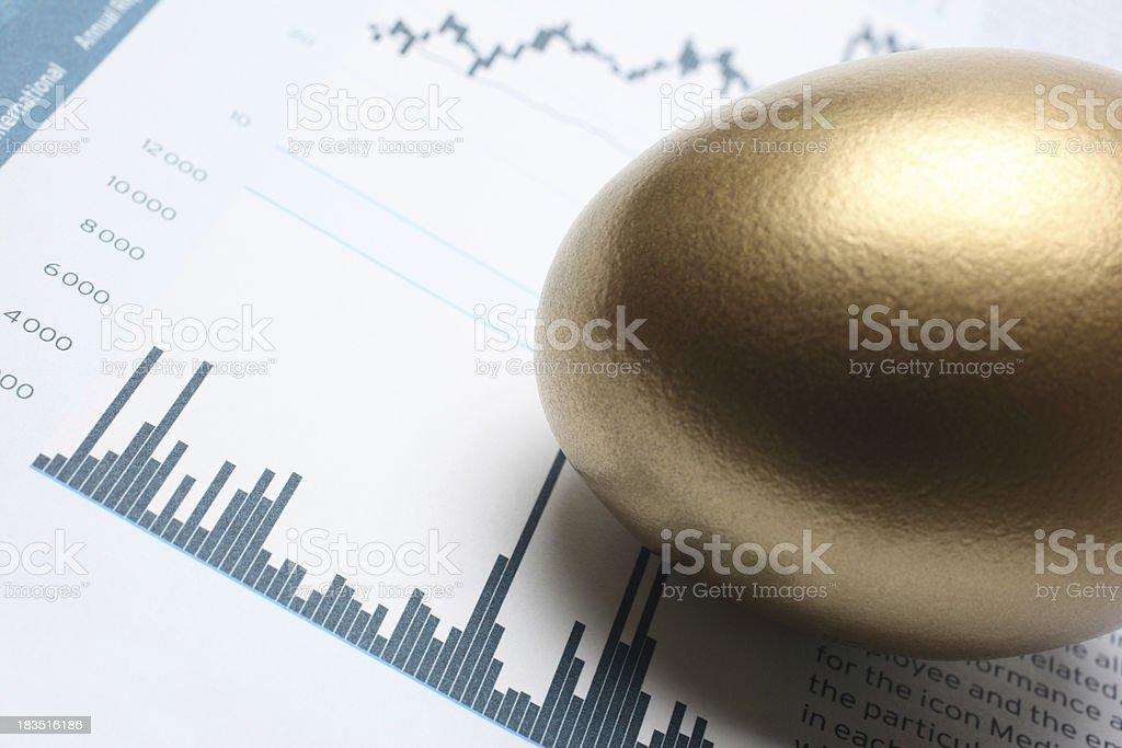 Golden Egg Sitting on Stock Market Chart royalty-free stock photo