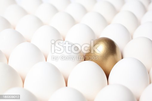 istock Golden Egg Standing Out from a Crowd of Ordinary Eggs 185309012