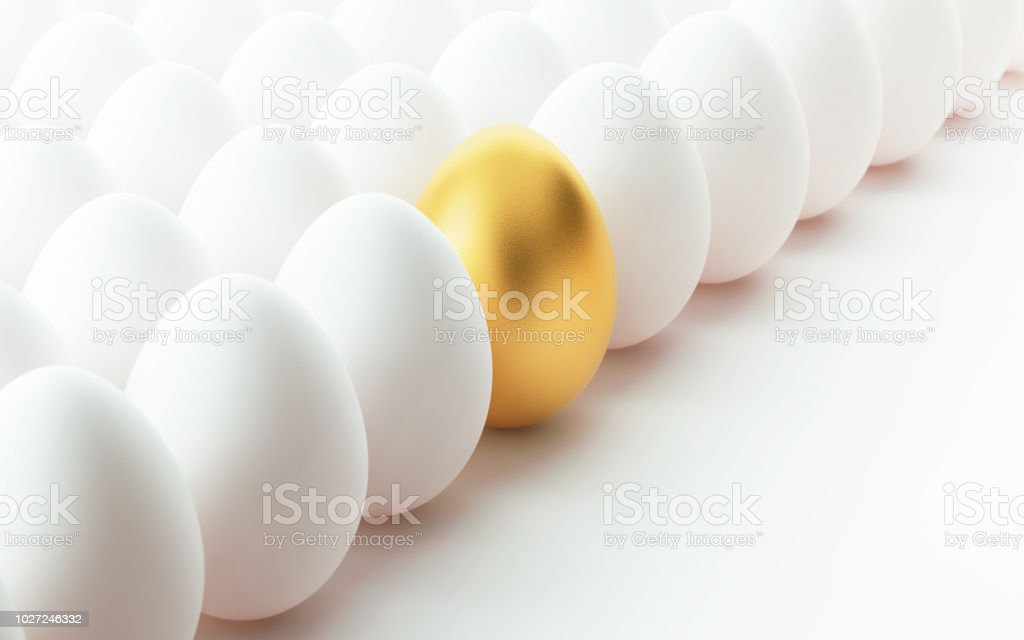 Golden Egg  Standing Out From The Crowd stock photo