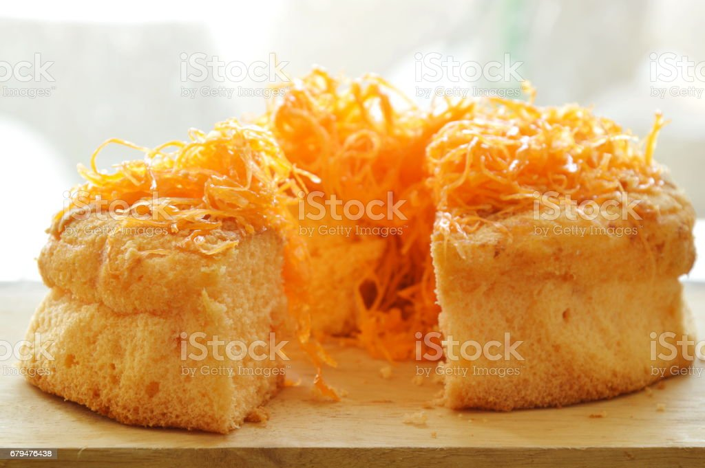 golden egg threads cake cut for piece on chop block royalty-free stock photo