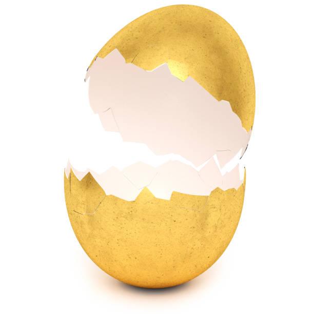 Golden egg with broken eggshell stock photo