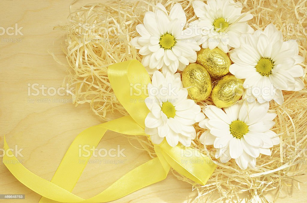Golden eggs and flowers for Easter stock photo