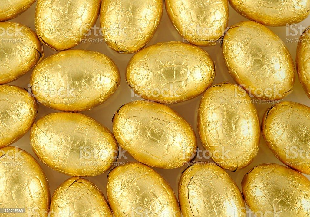 Golden eggs background stock photo