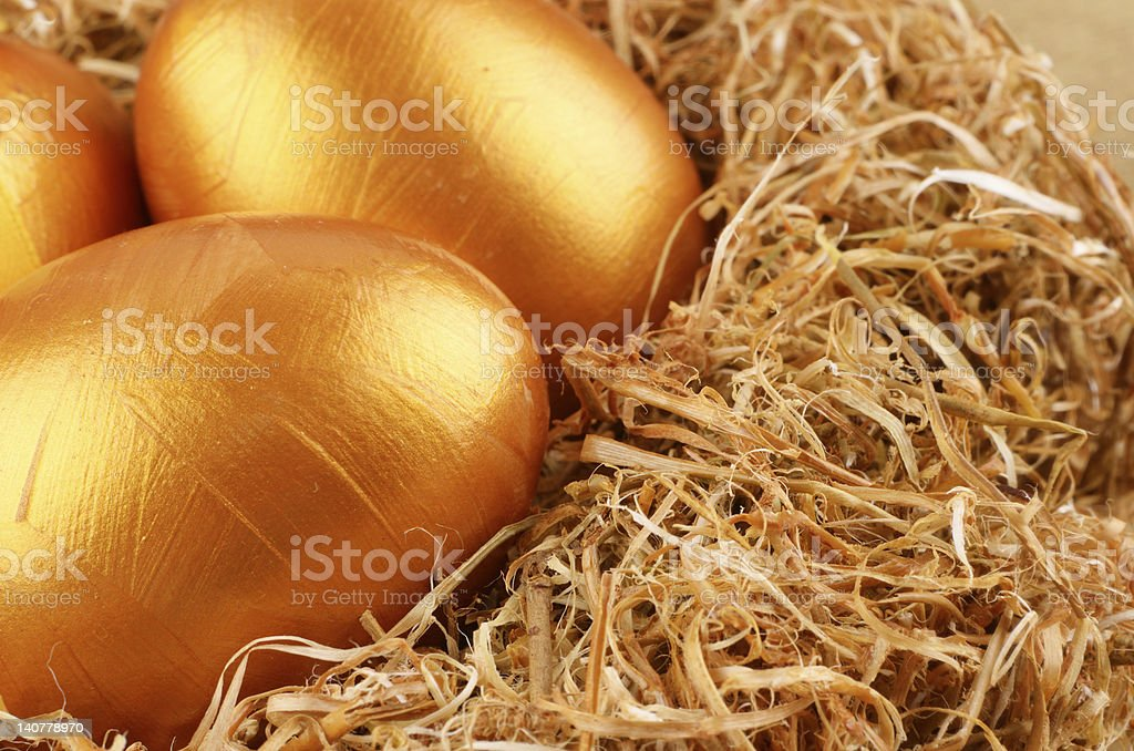 Golden eggs in the nest royalty-free stock photo