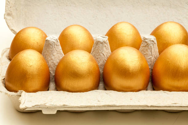Golden Eggs hand painted gold eggs in an egg carton deem stock pictures, royalty-free photos & images